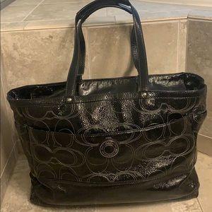 Black patent leather coach diaper bag.